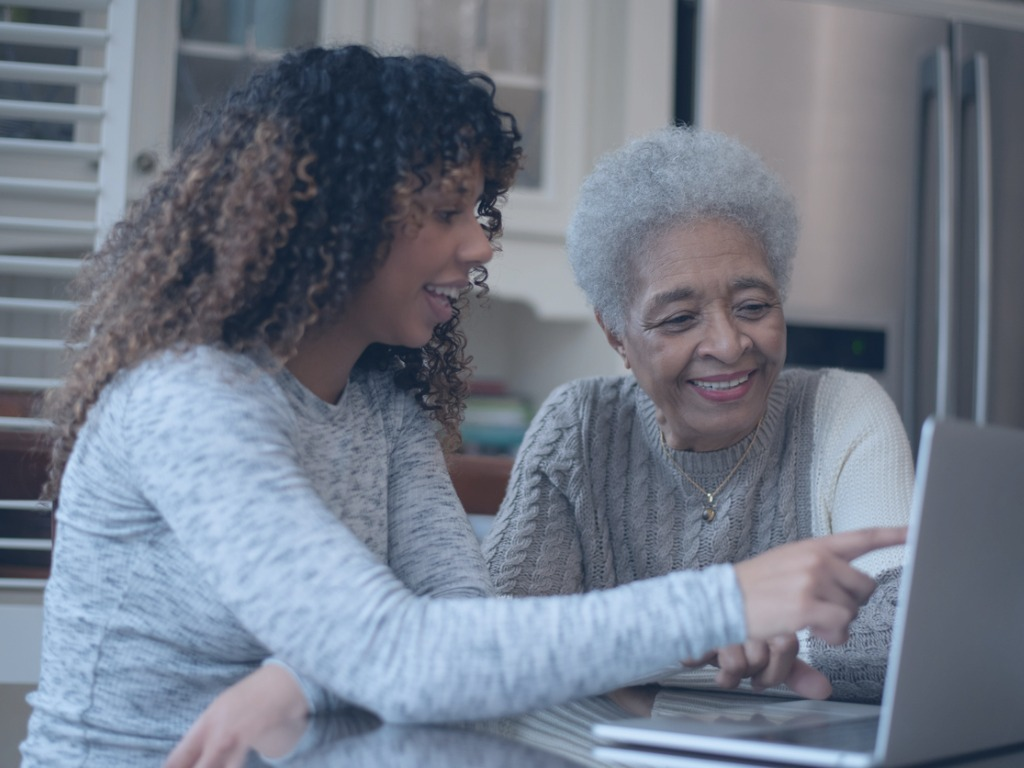 daughter-showing-senior-mother-how-to-video-chat-stock-photo-picture-id1186942331
